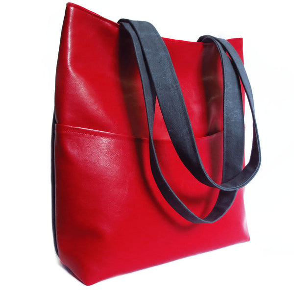 the back of the simone 517 tote is bright red vinyl with a deep pocket