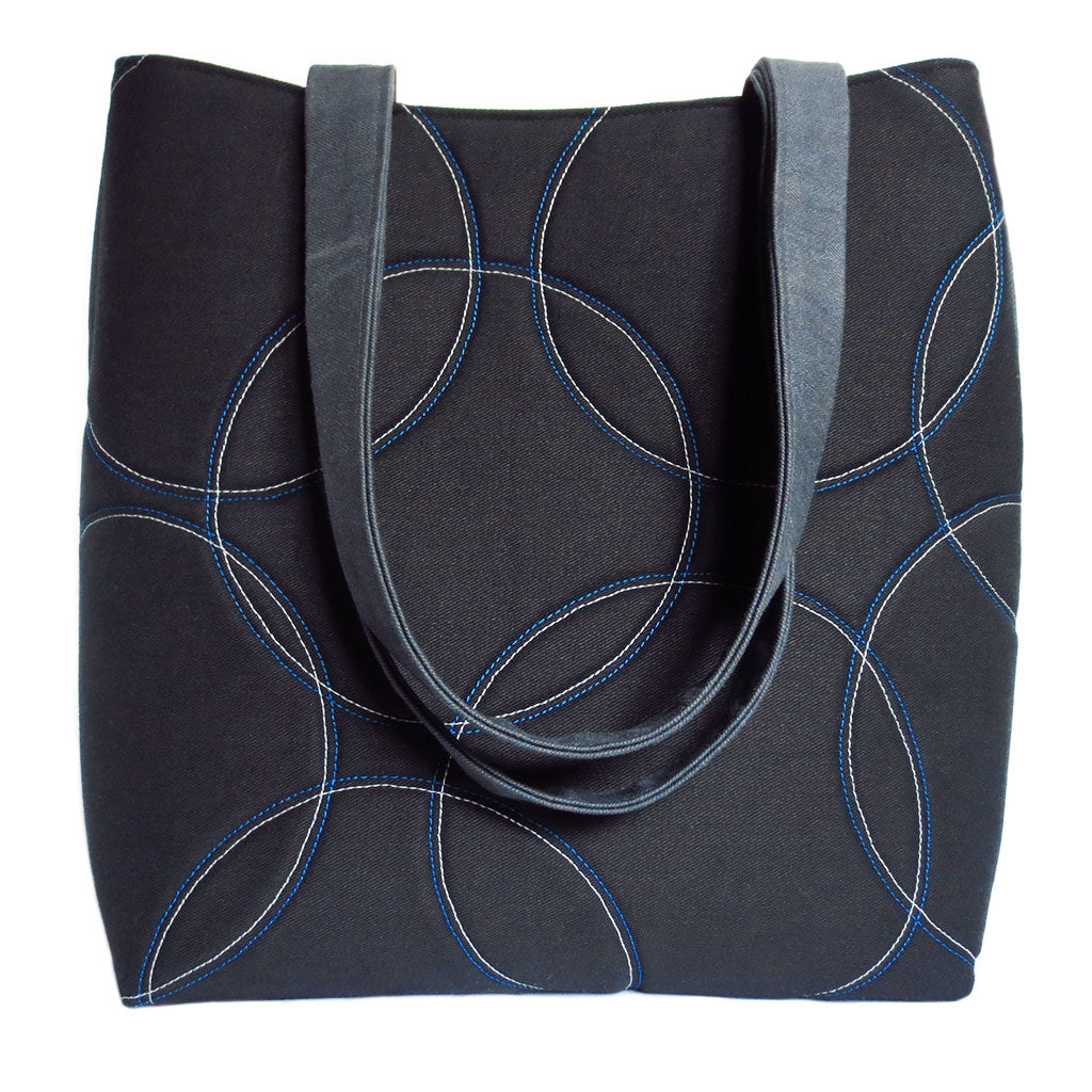 the sofia 517 tote with overlapping circles motif on black denim - from Holland Cox