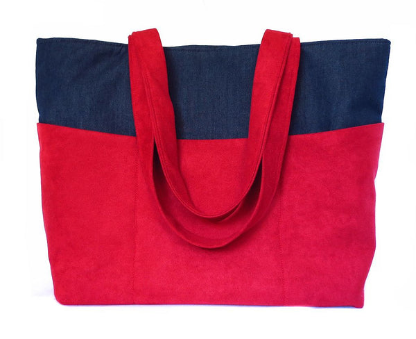back view of the anjelica tote bag, in red ultrasuede and dark blue denim
