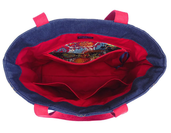 interior of the anjelica tote bag, with red twill lining and three large pockets
