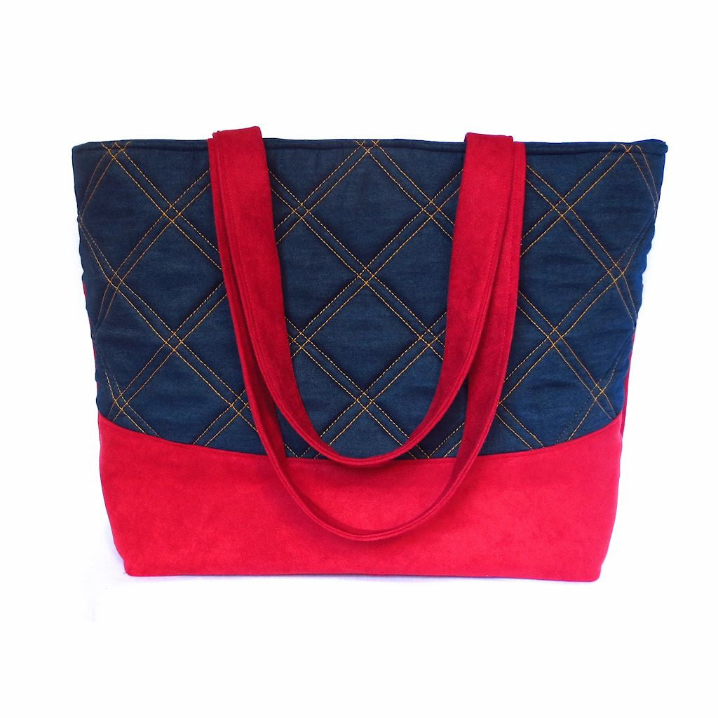 red ultra suede and denim tote, with windowpane check detail stitched in gold thread, from Holland Cox