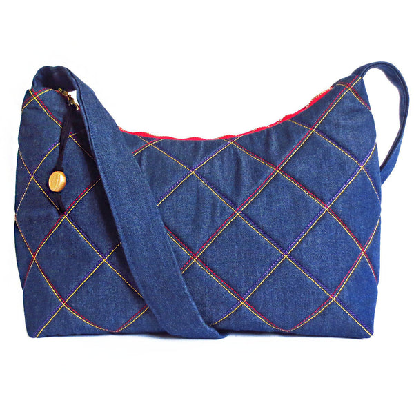 Denim handbag quilted in gold, purple and red from Holland Cox