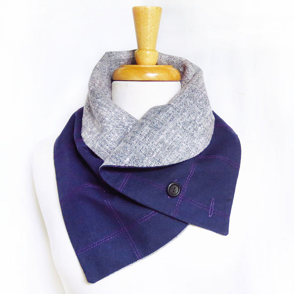 the anjelica button scarf with the curved edges folded over to create a collar