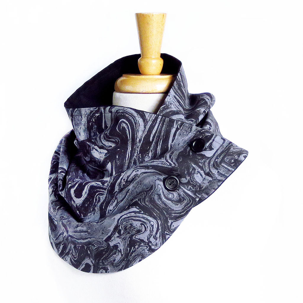 Fabric button scarf in black and gray marble print, lined in black linen, with two hand painted buttons in black.