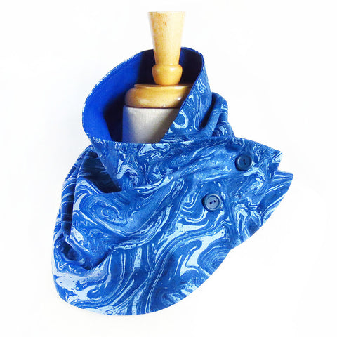 Fabric button scarf in blue marble print, lined in bright blue linen, with hand painted buttons in blue.