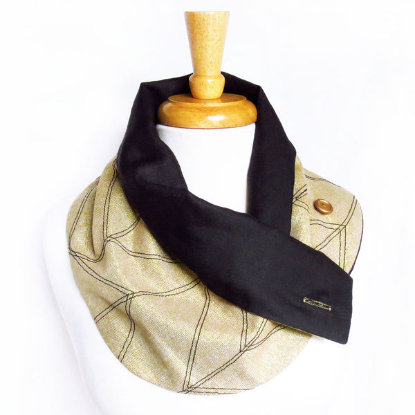 gold and black handmade scarf with one button undone