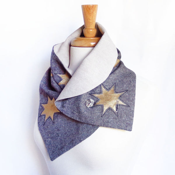 the octavia button scarf from Holland Cox styled as a collar