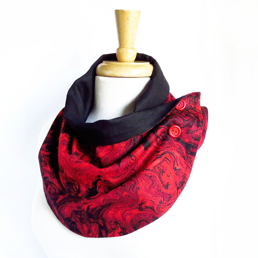 Fabric button scarf in red and black marble print, lined in black linen, with hand painted buttons in red.