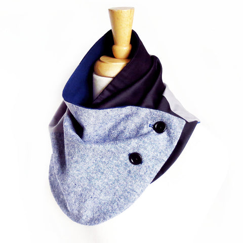 Modern patchwork fabric button scarf in blue, black, and gray. Lined in navy blue flannel with two hand painted buttons.