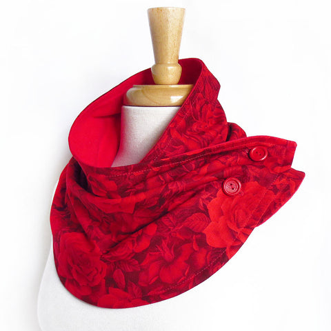 the rosetta button scarf is a tonal rose print in intense shades of dark red, with red painted buttons, and red flannel lining