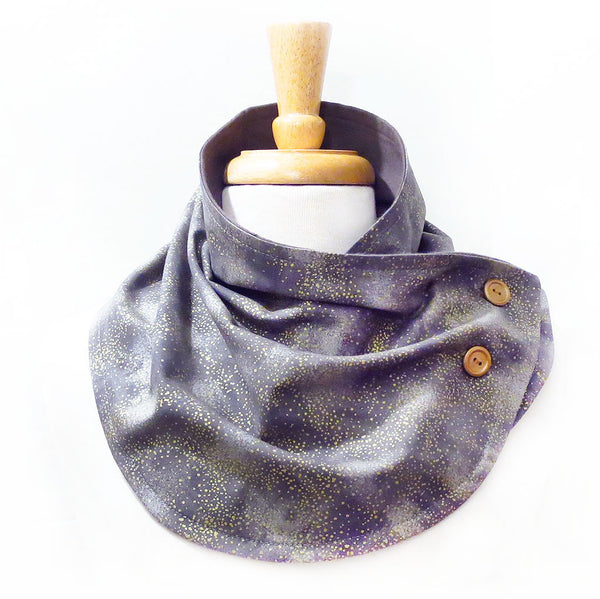 button scarf in subtle print of gold sprinkled on a gray background, lined in gray flannel with two gold hand painted buttons