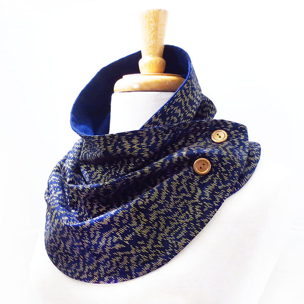 fabric button scarf in navy blue with small scale gold dash marks, buttoned with two hand painted gold buttons.