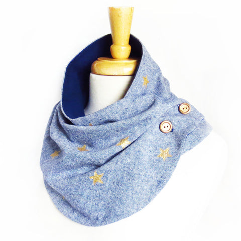 Fabric button scarf in blue essex linen, with small hand painted stars in metallic gold. Lined in navy blue cotton flannel, with hand painted wooden buttons in gold.