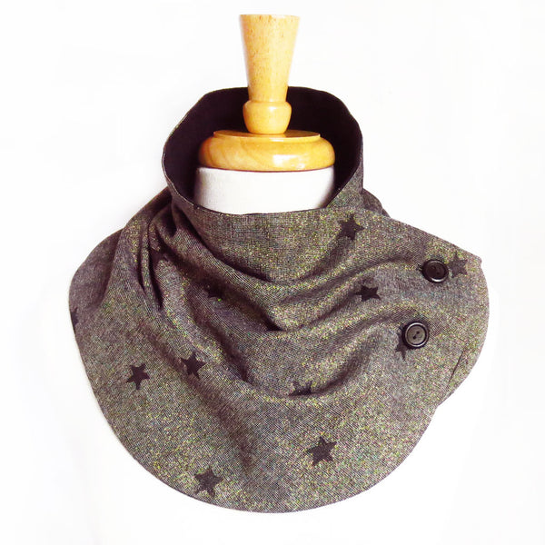 Fabric button scarf in metallic gold and black essex linen, hand painted with black stars, lined in black flannel with hand painted buttons in black.