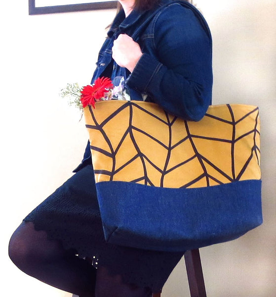 the Cassandra tote held by a model, showing its generous size