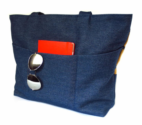 back view of the Cassandra tote, showing three deep pockets in dark blue denim