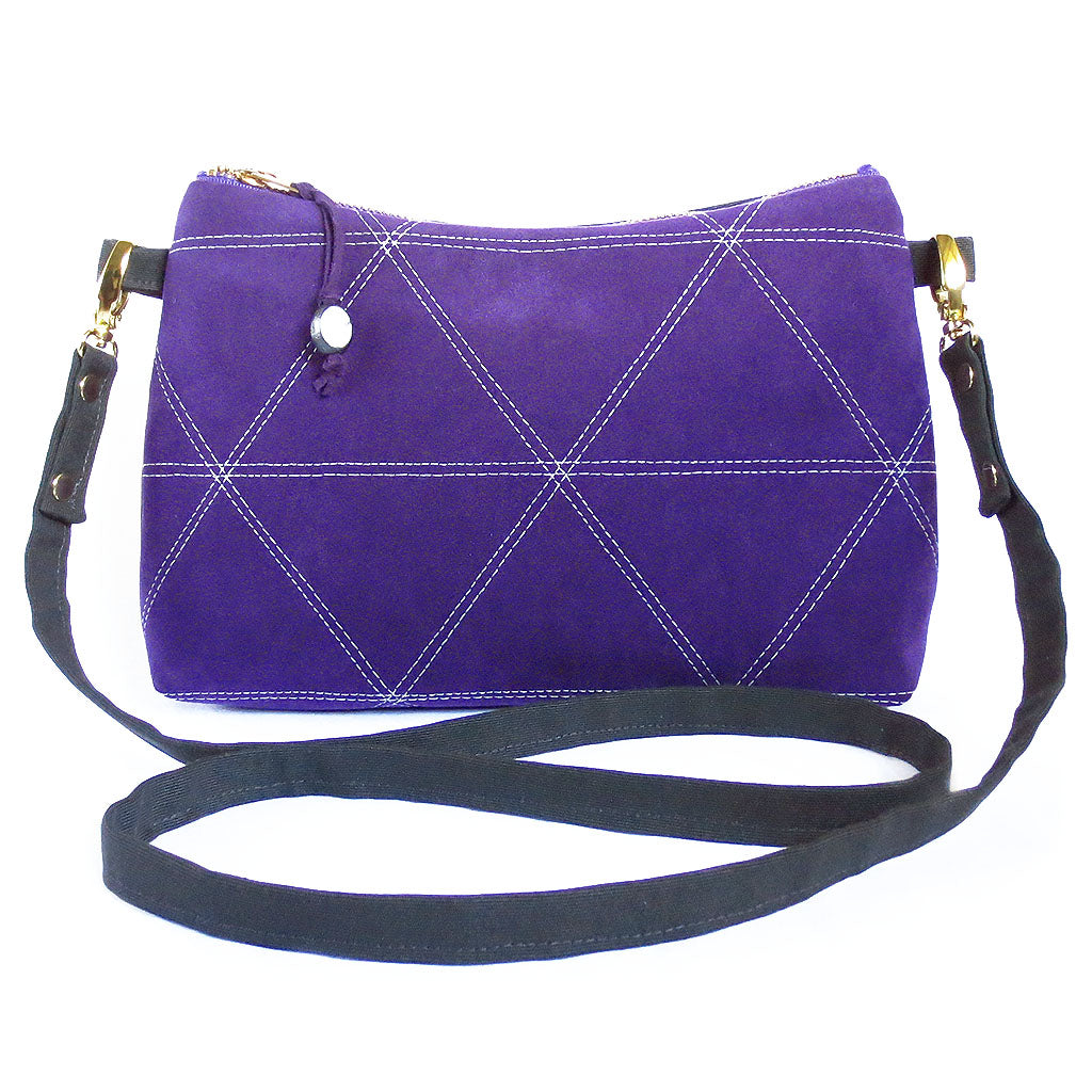bright purple ultrasuede and dark gray denim crossbody bag