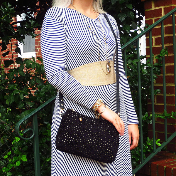 Emily is wearing the calliope crossbody bag and the selina wrap belt