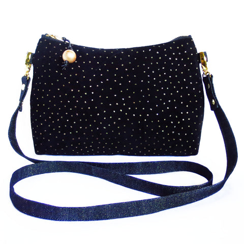 crossbody bag in black suede with gold metallic pin dots and dark metallic denim