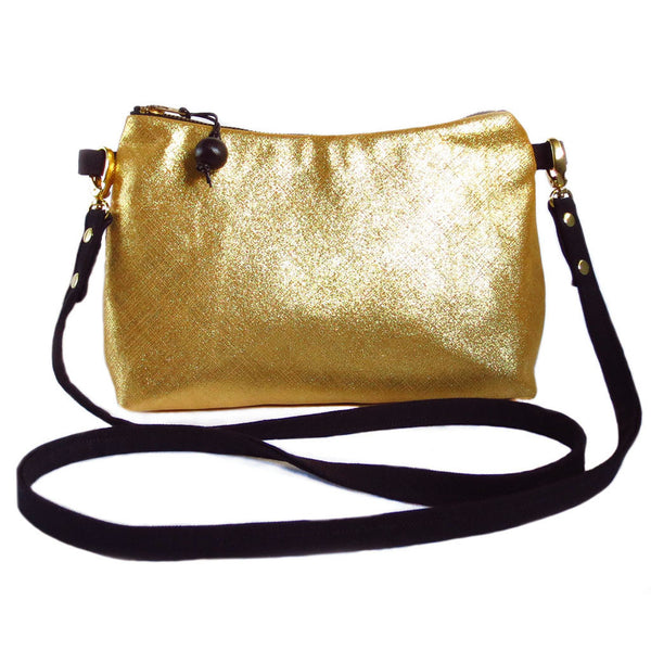Bright metallic gold leather and black denim crossbody bag.