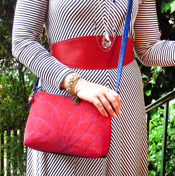 Emily wearing the persephone crossbody bag, and the aida wrap belt
