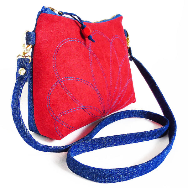 side view of the ultrasude and denim crossbody bag from Holland Cox