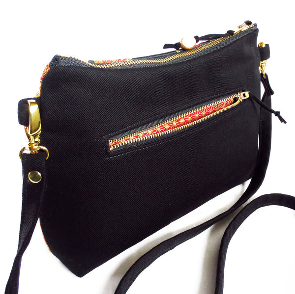 "the back pocket on the crossbody bag is 7"" wide and lined in a contrasting fabric"