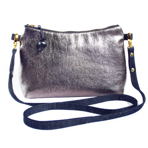 medium crossbody bag in pewter metallic leather and dark blue denim flecked with metallic thread.