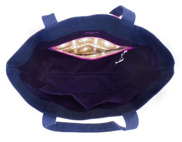 interior of the felicity tote bag, with purple sateen lining and a pocket lined in gold and white abstract print fabric