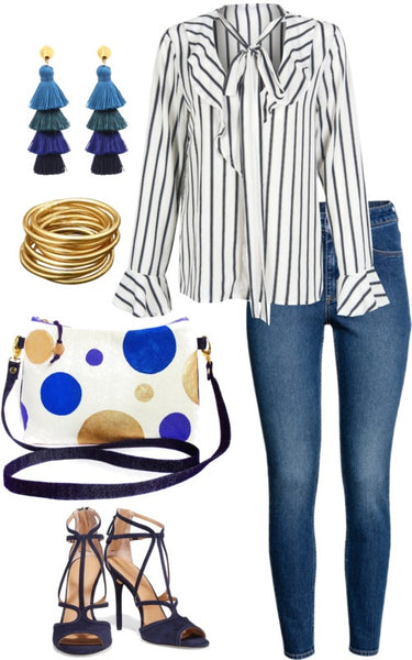 outfit idea for the felicity crossbody bag, featuring a striped blouse, skinny jeans, and tassel earrings