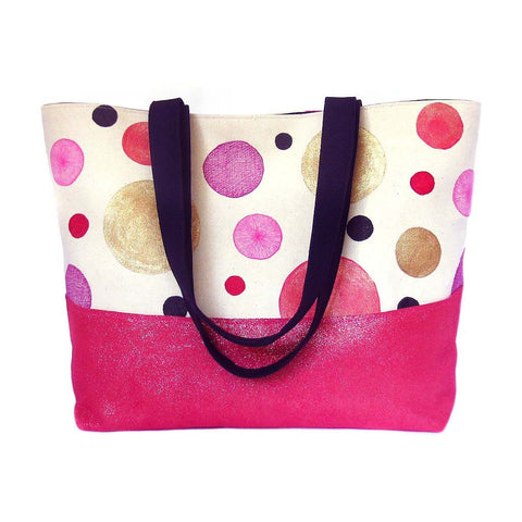 tote bag with hand drawn and painted polka dots in pink and gold with metallic pink leather accent