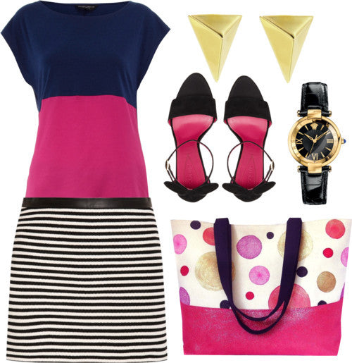 the felicity tote styled with a black and white mini skirt and color blocked blouse, gold jewelry, and black heels
