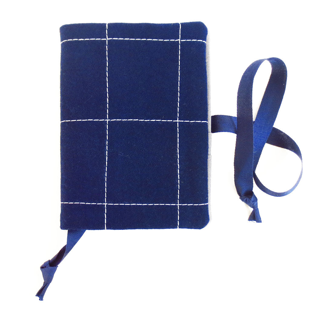 navy blue wool felt, stitched in large windowpane check in light gray thread.