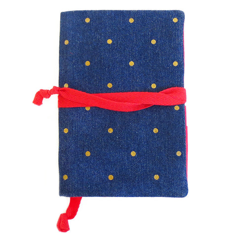 denim with gold polka dot field notes cover, lined in red with red bookmark and wrap tie