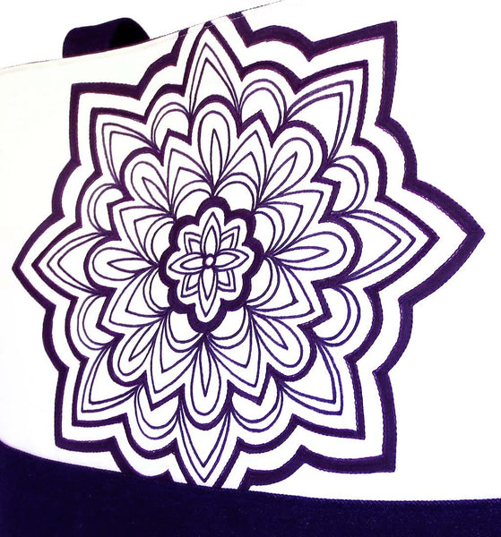 hand drawn mandala motif in black ink on off white fabric