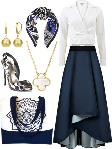 the gloria tote styled for the office, with a navy maxi skirt, white wrap top, and gold jewelry