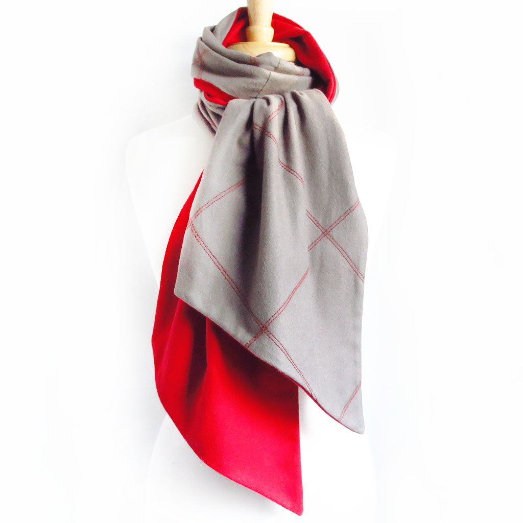 gray flannel scarf stitched with large scale windowpane check in red, and lined in red flannel. Wrapped and knotted around a dressform neck.