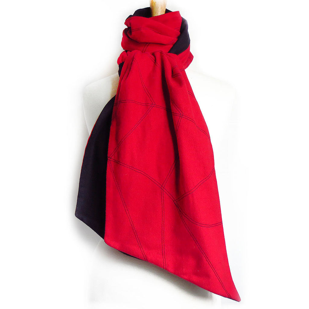 red and black flannel scarf stitched with chevron wave motif in black.