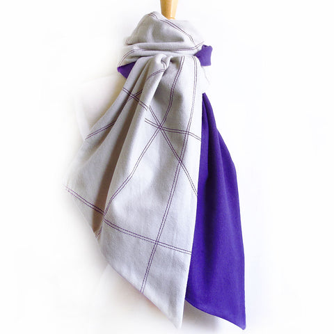 men's flannel scarf is stitched with abstract lines and lined with purple flannel