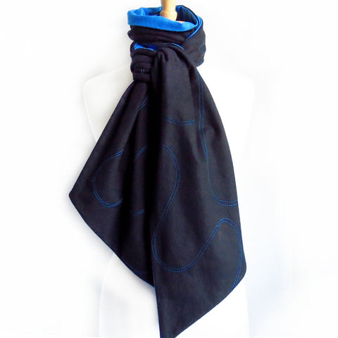 black flannel scarf with blue stitching and blue lining