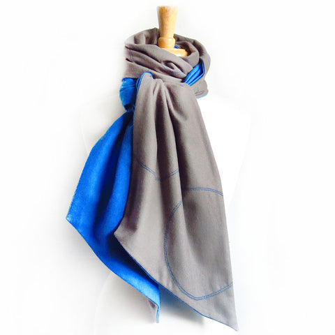 gray flannel scarf stitched with circle motif in bright blue, lined with blue flannel