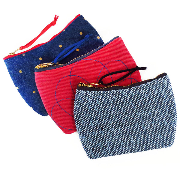 the parker, persephone, and lola mini pouches from Holland Cox