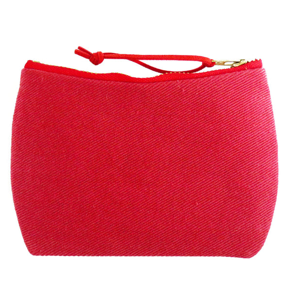 the back of the lola mini pouch is red denim