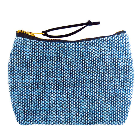 the parker mini pouch is blue and black cotton tweed