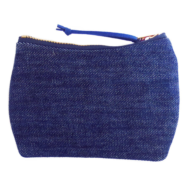the back of the persephone mini pouch is dark blue denim