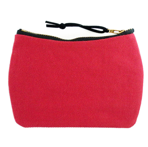 the back of the simone mini pouch is red denim