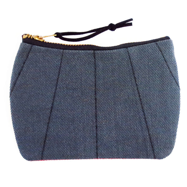 gray denim with black stitching on the front of the simone mini pouch
