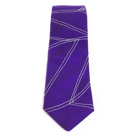Cotton necktie in purple and gray, stitched with the Holland Cox signature chevron wave motif.
