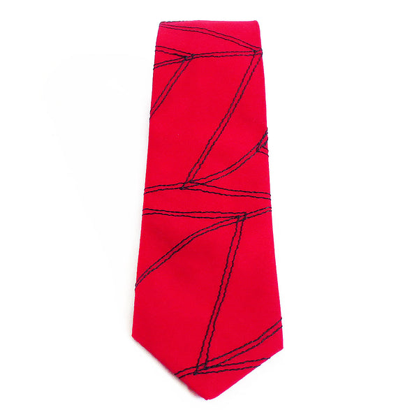 Cotton necktie in red, stitched with Holland Cox's signature chevron wave motif in black thread.