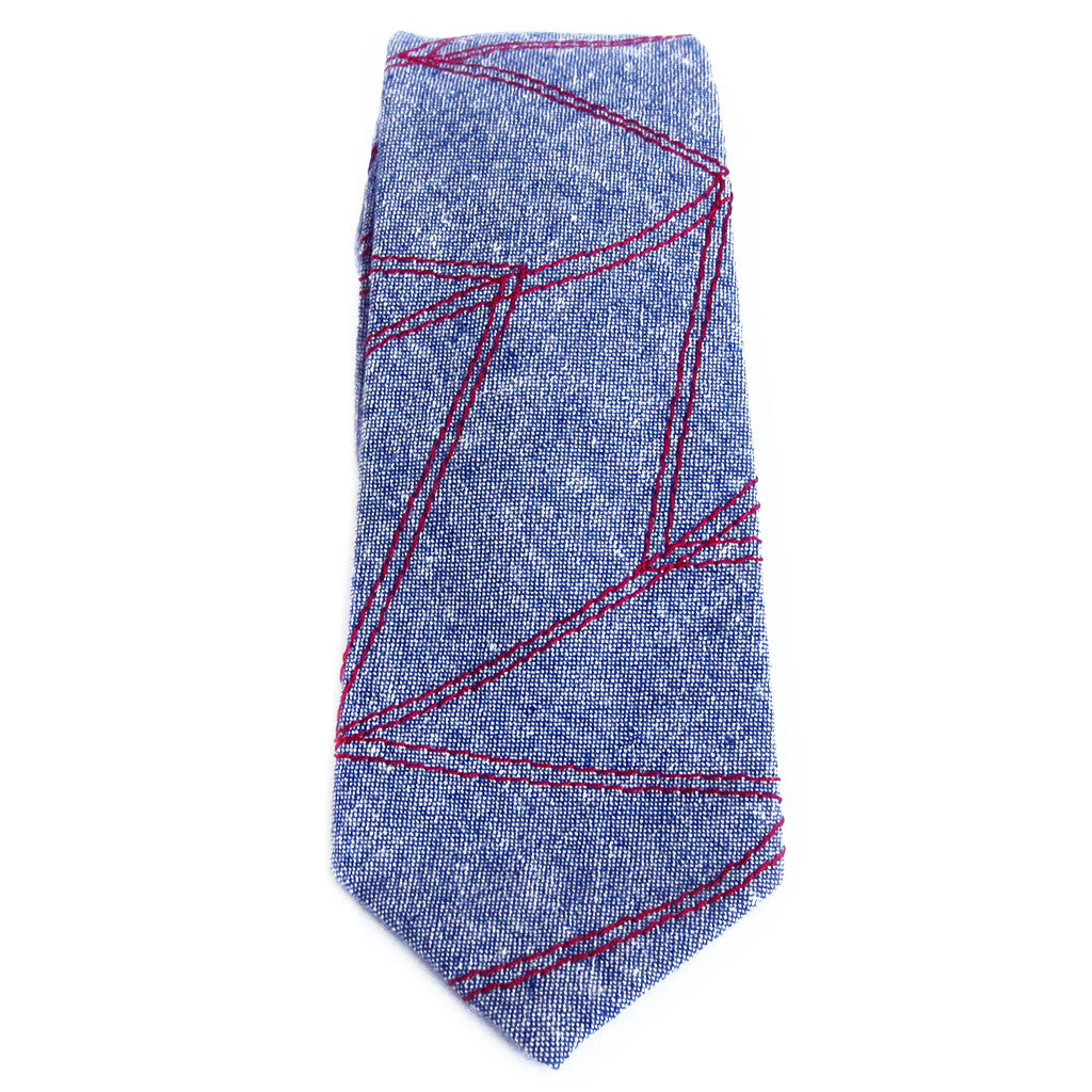 blue essex linen necktie stitched with chevron wave design in red heavy duty thread